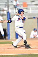 Kingsport Mets third baseman Eudor Garcia #44 swings at a pitch during a game against the Johnson City Cardinals at Hunter Wright Stadium August 24, 2014 in Kingsport, Tennessee. The Mets defeated the Cardinals 9-1. (Tony Farlow/Four Seam Images)