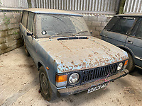 BNPS.co.uk (01202) 558833. <br /> Pic: Symonds&Sampson/BNPS<br /> <br /> Pictured: Rusty Range Rover anyone? <br /> <br /> A cache of more than 38 classic cars, lorries, motorcycles and tractors spanning six decades are up for auction after being found in a barn belonging to a collector. <br /> <br /> The collection includes Fords imported from America, original two-door Range Rovers and an MG MGA sports car which can sell for more than £50,000 when fully restored. <br /> <br /> The cars are being sold by auctioneers on behalf of the beneficiaries of the recently deceased classic car enthusiast Kelvin Pike, in an online-only auction which ends on Tuesday (June 15).