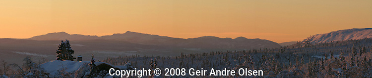 Sunrise with view towards Ringeby, in the Norwegian mountains one cold winters morning