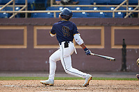 TJ Ash (13) of the North Carolina A&T Aggies follows through on his swing against the North Carolina Central Eagles at Durham Athletic Park on April 10, 2021 in Durham, North Carolina. (Brian Westerholt/Four Seam Images)