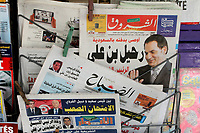 Newspapers headlining the death of former Tunisian President Ben Ali are picured in Tunis on September 20, 2019. - Tunisia's all-powerful leader for two decades, Zine El Abidine Ben Ali was forced from power and into exile by a landmark popular uprising in early 2011, sparking revolts across the Arab world. The man who once appeared in official portraits with a benevolent smile and jet black hair died on September 19, 2019 aged 83, in Saudi Arabia, Tunisia's foreign ministry said.