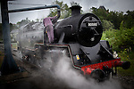 © Joel Goodman - 07973 332324 . 24/05/2014 . Heywood Station , Railway Street , Heywood, UK . Filling up the steam engine with water from the tower . 1940s weekend on the East Lancs Railway , with visitors dressed up and partaking in 40s-themed events . Photo credit : Joel Goodman