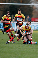 Tom Hodgson of Richmond Rugby is pulled down by Tom Burns of Blackheath Rugby during the English National League match between Richmond and Blackheath  at Richmond Athletic Ground, Richmond, United Kingdom on 4 January 2020. Photo by Carlton Myrie.