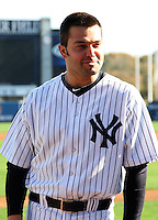 February 25, 2010:  Nick Swisher of the New York Yankees during listens to instruction during photo day at Legends Field in Tampa, FL.  Photo By Mike Janes/Four Seam Images