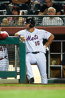 Scottsdale Scorpions left fielder Tim Tebow (15), of the New York Mets organization, waits for his turn at bat in the dugout during a game against the Salt River Rafters on October 12, 2016 at Scottsdale Stadium in Scottsdale, Arizona.  Salt River defeated Scottsdale 6-4.  (Mike Janes/Four Seam Images)