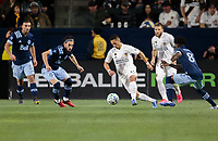 CARSON, CA - MARCH 07: Chicharito #14 of the Los Angeles Galaxy moves with the ball during a game between Vancouver Whitecaps and Los Angeles Galaxy at Dignity Health Sports Park on March 07, 2020 in Carson, California.