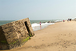Caister on Sea, coastal erosion. Second world war concrete military pillbox designed to repel a Nazi invasion of Britain, formally on dry land now on the beach.
