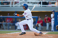 Raphael Ramirez (21) of the Kingsport Mets follows through on his swing against the Elizabethton Twins at Hunter Wright Stadium on July 9, 2015 in Kingsport, Tennessee.  The Twins defeated the Mets 9-7 in 11 innings. (Brian Westerholt/Four Seam Images)