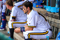Iowa Cubs shortstop Ryan Court (13) sits in the dugout during a Pacific Coast League game against the Colorado Springs Sky Sox on June 23, 2018 at Principal Park in Des Moines, Iowa. Colorado Springs defeated Iowa 4-2. (Brad Krause/Four Seam Images)