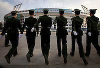 Military police practice marching at the Workers' Stadium in Beijing, which is getting ready to host the 2008 Olympic Games..