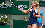 Dominika Cibulkova (SVK) battles against a heavily bandaged Samantha Stosur (AUS) at  Roland Garros being played at Stade Roland Garros in Paris, France on May 30, 2014
