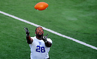 Jun. 13, 2009; Las Vegas, NV, USA; Tyson Thompson makes a catch during the United Football League workout at Sam Boyd Stadium. Mandatory Credit: Mark J. Rebilas-