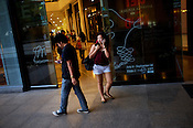 Young filipino shoppers seen using the mobile phone while walking around the Greenbelt mall in the city of Makati in the Philippines. Photo: Sanjit Das