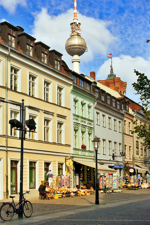 Berlin, Germany.   Street with souvenir shops and restaurants in Nikolai-viertel.  Fernsehturm in distance.