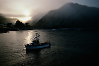 "A salmon fishing boat circles in a quiet harbor at dawn beginning a work day on the water. The first European to record Point Arena was Spaniard Bartolomé Ferrelo in 1543, who named it Cabo de Fortunas (Spanish for ""cape of fortunes"")."