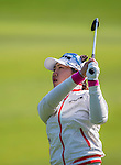 Ji-Hyun Kim of Korea plays a shot during the Hyundai China Ladies Open 2014 at World Cup Course in Mission Hills Shenzhen on December 13 2014, in Shenzhen, China. Photo by Li Man Yuen / Power Sport Images