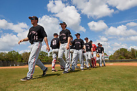 Ball State Cardinals Chandler Hughes (14), Nolan Gazouski (10), Justin Conant (15), and Landon McGill (43) high five teammates after a game against the Saint Joseph's Hawks on March 9, 2019 at North Charlotte Regional Park in Port Charlotte, Florida.  Ball State defeated Saint Joseph's 7-5.  (Mike Janes/Four Seam Images)