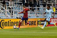 SAINT PAUL, MN - APRIL 24: Nick Besler #13 of Real Salt Lake and Justin McMaster #24 of Minnesota United FC chase down the ball during a game between Real Salt Lake and Minnesota United FC at Allianz Field on April 24, 2021 in Saint Paul, Minnesota.