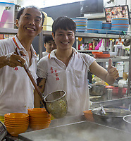 Kitchen Workers in Lou Wong Restaurant, Famous for Chicken, Rice, and Bean Sprouts (Tauge Ayam).  Ipoh, Malaysia.