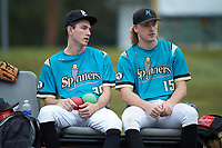 Mooresville Spinners starting pitcher Justin Jarvis (39) sits in the bullpen next to Brennen Oxford (15) (Wake Forest) prior to the exhibition game against the Race City Bootleggers at Moor Park on July 23, 2020 in Mooresville, NC. Jarvis was a 2018 5th round draft pick of the Milwaukee Brewers out of Lake Norman (NC) High School.  With the 2020 Minor League Baseball season canceled, Jarvis was given permission to pitch for the Spinners, who play in the Southern Collegiate Baseball League.  (Brian Westerholt/Four Seam Images)