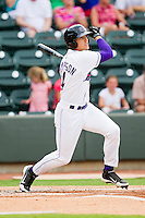 Trayce Thompson #24 of the Winston-Salem Dash follows through on his swing against the Myrtle Beach Pelicans at BB&T Ballpark on July 5, 2012 in Winston-Salem, North Carolina.  The Dash defeated the Pelicans 12-5.  (Brian Westerholt/Four Seam Images)