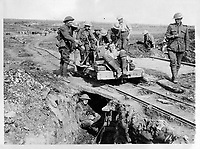 With the Canadians in the great battle<br /> Description<br /> <br /> Bringing in a wounded Canadian on a truck from the battle of Courcelette<br /> , FRANCE.<br /> <br /> <br /> <br /> 15 september 1916