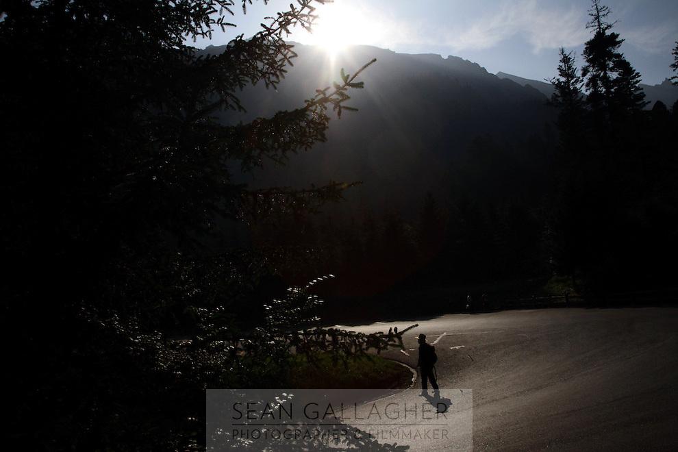 A tourist walks down a road in the Jiuzhaigou National Park. Sichuan Province. China.