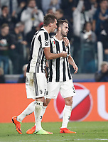 Football Soccer: UEFA Champions League Juventus vs Sporting Clube de Portugal, Allianz Stadium. Turin, Italy, October 18, 2017. <br /> Juventus' Mario Mandzukic (l) celebrates after scoring with his teammates Miralem Pjanic (r) during the Uefa Champions League football soccer match between Juventus and Sporting Clube de Portugal at Allianz Stadium in Turin, October 18, 2017.<br /> UPDATE IMAGES PRESS/Isabella Bonotto