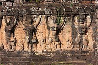 Cambodia, Angkor Thom.  Garuda Figures Holding up the Walkway adjacent to the Elephant Terrace.