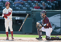 Arkansas second baseman Robert Moore tosses his bat Wednesday, April 7, 2021, after drawing a walk during the first inning of the Razorbacks' 10-3 win over UALR at Baum-Walker Stadium in Fayetteville. Moore would score on a three-run home run by first baseman Brady Slavens. Visit nwaonline.com/210408Daily/ for today's photo gallery. <br /> (NWA Democrat-Gazette/Andy Shupe)