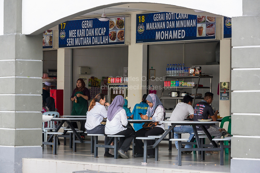 Malaysian Women Having Lunch at Food Vendors Shared Seating Area, Ipoh, Malaysia.