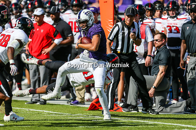 TCU Horned Frogs quarterback Kenny Hill (7) in action during the game between the Texas Tech Red Raiders and the TCU Horned Frogs at the Amon G. Carter Stadium in Fort Worth, Texas.