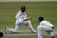 16th April 2021; Emirates Old Trafford, Manchester, Lancashire, England; English County Cricket, Lancashire versus Northants; Saif Zaib of Northamptonshire sweeps as Rob Jones of Lancashire looks on