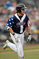 First baseman Dash Winningham (34) of the Columbia Fireflies runs out a batted ball in a game against the Rome Braves on Monday, July 3, 2017, at Spirit Communications Park in Columbia, South Carolina. Columbia won, 1-0. (Tom Priddy/Four Seam Images)