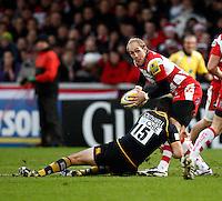 Photo: Richard Lane/Richard Lane Photography. Gloucester Rugby v London Wasps. Aviva Premiership. 26/12/2011. Gloucester's Olly Morgan is tackled by Wasps' Hugo Southwell.