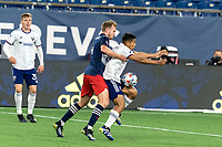FOXBOROUGH, MA - APRIL 24: Edison Flores #10 of D.C. United attempts to control the ball as Henry Kessler #4 of New England Revolution pressures during a game between D.C. United and New England Revolution at Gillette Stadium on April 24, 2021 in Foxborough, Massachusetts.