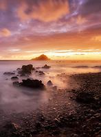 Sunrise at Koki beach and Alau Island at sunrise. Maui, Hawaii