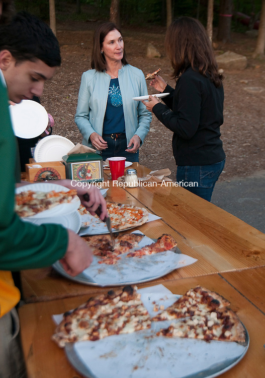 WATERTOWN, CT--051415JS20- Leslie Segal of Woodbury and Kim Demsey of Waetrtown, chat while other guests get some pizza during the Greater Waterbury Campership Fund's third annual Big Green Pizza Truck appearanceThursday, at the Waterbury YMCA's Camp Mataucha in Watertown.<br /> Jim Shannon Republican-American