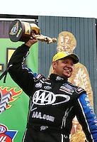 Apr 27, 2014; Baytown, TX, USA; NHRA funny car driver Robert Hight celebrates after winning the Spring Nationals at Royal Purple Raceway. Mandatory Credit: Mark J. Rebilas-