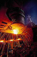 A steel worker welding.