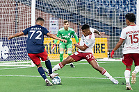 FOXBOROUGH, MA - JUNE 26: Alisson #27 of North Texas SC tackles Damian Rivera #72 of the New England Revolution near the North Texas SC goal during a game between North Texas SC and New England Revolution II at Gillette Stadium on June 26, 2021 in Foxborough, Massachusetts.