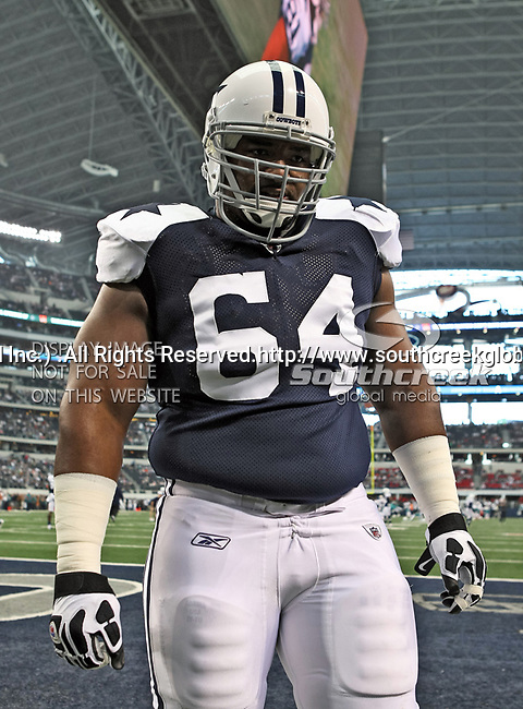 Dallas Cowboys guard Montrae Holland (64) in action during the Thanksgiving Day game between the Miami Dolphins and the Dallas Cowboys at the Cowboys Stadium in Arlington, Texas. Dallas defeats Miami 20 to 19...