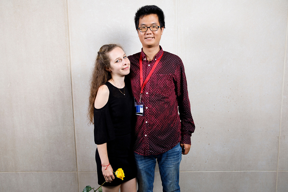Contestant Yana Lyashko poses with guest at a photo booth during the opening reception and dinner of the 11th USA International Harp Competition at Indiana University in Bloomington, Indiana on Wednesday, July 3, 2019. (Photo by James Brosher)