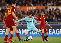 FC Barcelona Lionel Messi, center, is challenged by Roma s Alessandro Florenzi during the Uefa Champions League quarter final second leg football match between AS Roma and FC Barcelona at Rome's Olympic stadium, April 10, 2018.<br /> UPDATE IMAGES PRESS/Riccardo De Luca
