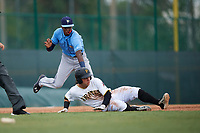 Tampa Bay Rays Osmy Gregorio (76) tags Wyatt Mathisen (10) out in a rundown during an Instructional League game against the Pittsburgh Pirates on October 3, 2017 at Pirate City in Bradenton, Florida.  (Mike Janes/Four Seam Images)