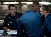 120319-N-DR144-310 ARABIAN SEA (March 19, 2012) Chief Electrician's Mate (AW/SW) Kurt Schriever, assigned to the Reactor Department's RE Division, is briefed by Sailors before they perform maintenance on a phone system aboard the Nimitz-class aircraft carrier USS Carl Vinson (CVN 70). Carl Vinson and Carrier Air Wing (CVW) 17 are deployed to the U.S. 5th Fleet area of responsibility.  (U.S. Navy photo by Mass Communication Specialist 2nd Class James R. Evans/Released)