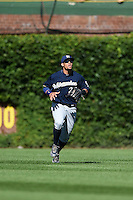 Milwaukee Brewers outfielder Carlos Gomez (27) tracks down a fly ball during a game against the Chicago Cubs on August 14, 2014 at Wrigley Field in Chicago, Illinois.  Milwaukee defeated Chicago 6-2.  (Mike Janes/Four Seam Images)