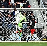 WASHINTON, DC - FEBRUARY 29: Washington, D.C. - February 29, 2020: Bill Hamid #24 of D.C. United battles the ball with Kei Kamara #23 of the Colorado Rapids. The Colorado Rapids defeated D.C. United 2-1 during their Major League Soccer (MLS)  match at Audi Field during a game between Colorado Rapids and D.C. United at Audi FIeld on February 29, 2020 in Washinton, DC.