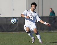 University of Connecticut defender Flo Liu (16) passes the ball. .NCAA Tournament. University of Connecticut (white) defeated Northeastern University (black), 1-0, at Morrone Stadium at University of Connecticut on November 18, 2012.