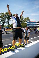 Jun 11, 2017; Englishtown , NJ, USA; Crew members for NHRA pro stock motorcycle rider Jerry Savoie celebrate after winning the Summernationals at Old Bridge Township Raceway Park. Mandatory Credit: Mark J. Rebilas-USA TODAY Sports
